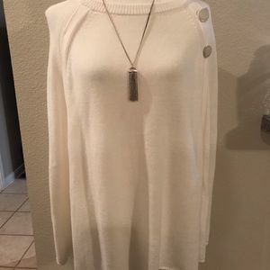 White poncho with gold button detail